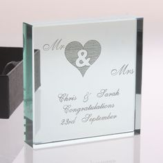 A fantastic gift idea for a Bride and Groom or a couple celebrating a special anniversary, this Mr and Mrs keepsake is engraved with a personal message and a loving Mr & Mrs heart design. A wonderful memento of any special occasion in a couples life.