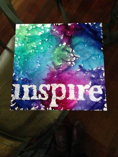 Melted crayon art with acrylic stamped word overtop