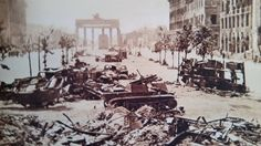 Wrecked military vehicles in front of Brandenburg Gate during the Battle of Berlin