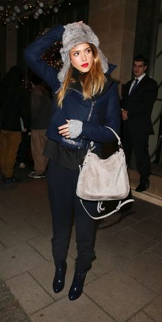 Jessica Alba wearing a fur hat and fingerless gloves in London.