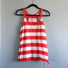 Old Navy | Loose Striped Tank A loose fitting striped tank with a cinch-tie hem & one front pocket. Coral/White stripe color. Worn once (but way too big for me). Size M. Price is firm. Old Navy Tops Tank Tops