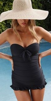 a one piece I can get into. such a chic poolside look with that big straw hat. summer please!