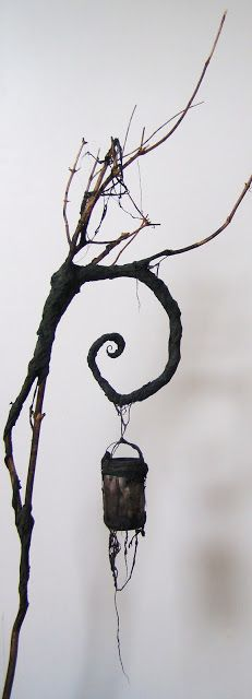 lantern holder... Click on it to see the little creature holding it! Very spooky!! I'm definitely going to need a couple of these for my graveyard this year.
