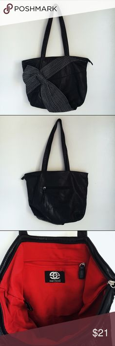 Marc Ecko Black sash tote bag Great condition Marc Ecko hobo shoulder bag. Black faux leather with a cute half bow half sash embellishment on the front. Very roomy. Marc Ecko Bags Satchels
