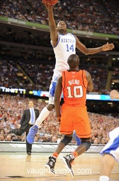 MKG spins and scores. Check out Coach Cal in the background