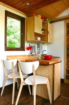 Tall Man's Tiny House, such a great kitchen. love the little eating bar.
