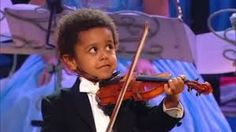 "Nice Black To The Future: Akim Camara (5yr) Playing A Portion Of ""Dance of the Fairies"""