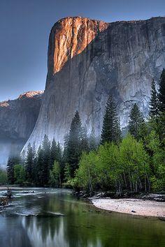 The early morning sun and fog, El Capitan, Yosemite National Park, California
