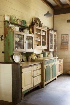 Clever use of old country hutches in a vintage cottage kitchen. Create a rustic, chippy look on newer cupboards and cabinets with Chalk Paint and Artisan Enhancements Crackle Tex!