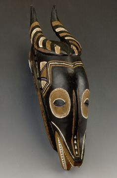 Wooden mask representing an antelope head, West-Africa. Museon, CC BY
