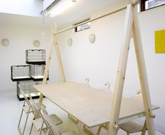 chairs hang on top pole of table