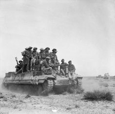 A Valentine tank carries infantry during an exercise,  Tunisia, 12 March 1943.
