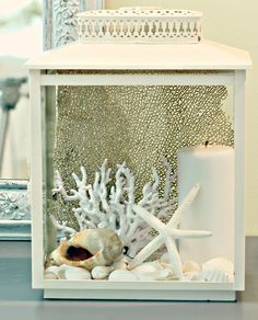 I don't think I'd ever have a beach themed room, but I love the idea of putting decorative items inside a lantern.