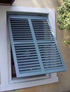 white bahama style exterior shutters by the louver shop beach