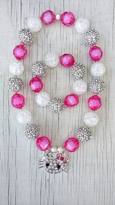 Check out this item in my Etsy shop https://www.etsy.com/listing/486776073/hello-kitty-hot-pink-silver-stretchy