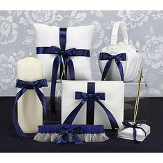 Ivory Custom Ribbon Collection  Ivory collection accented with satin bows. Choose the ribbon color of your choice. This collection includes unity candle, ring pillow, flower basket, guest book, pen set and garter. You may purchase the complete set of 6 blank items for a reduced price or purchase certain pieces individually at regular price.