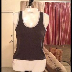 """Victoria's Secret Top Victoria's Secret Top is made of 100% Cotton. Size Small. The color is Gray with Baby Blue trim. This Top stretches. Length """"21. Laying flat """"15. This item is in Good condition, Authentic and from a Smoke And Pet free home. All Offers through the offer button ONLY. I Will not negotiate Price in the comment section. Thanks  Victoria's Secret Tops"""