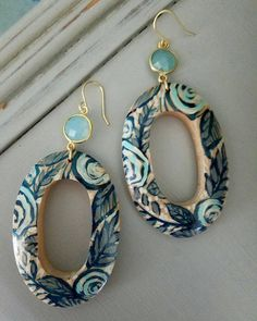 Handpainted wooden open oval earrings. Beautiful, simple flower and leaf pattern in navy, gray, Ivory and light blue