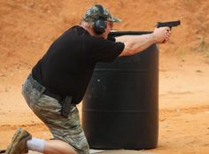 Ben Shooting Around Cover at IDPA Classifier