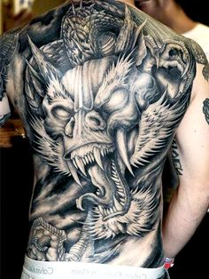 Killer Japanese Dragon tattoo on his back. For more tattoo designs and ideas, visit www.tattooenigma.com