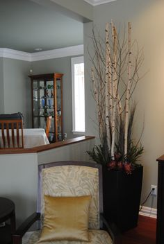 Tall Birch Branches add drama to this clients family room without having the maintenance of taking care of live plants