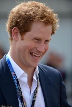 Someone's happy: Prince Harry appeared to be having the time of his life at the Grand Prix this weekend, where he was seen chatting to racin...