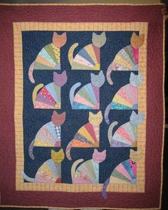 Grandma's Fan Cats quilt, It's adapted from a pattern in The Cat's Meow by Janet Kime.