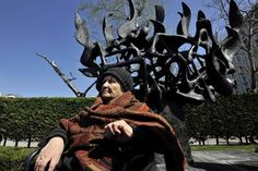 Holocaust survivor Janna Saatsoglou sits in front of a Holocaust monument during the 70th anniversary of the first deportation of Jews from Thessaloniki, Greece to the death camps in March 1943