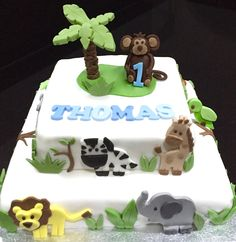 Animal themed Birthday cake for a 1st birthday party!  Check out all my cakes and cupcakes on my website. I am based in Leek, Staffordshire and deliver in Leek and Stoke areas!