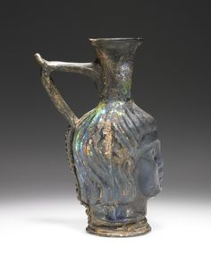 Mold-blown Head flask; Unknown; Eastern Mediterranean; 4th - 5th century; Glass; 17 cm (6 11/16 in.); 2004.44