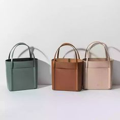 Bucket bags, leather totes in teal beige and light pink