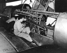 WAVES Aviation Machinist's Mates working on a SNJ training aircraft, Naval Air Station, Pensacola, Florida, 5 Mar 1944 (US National Archives)
