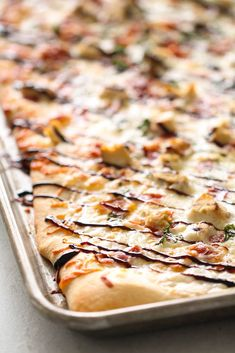Copycat Blaze White Top Pizza Recipe - Six Sisters' Stuff | This 30 minute pizza has a perfect chewy crust and is topped with white sauce, mozzarella cheese, bacon, chicken, garlic, oregano, arugula and a drizzle of balsamic glaze. Seriously, is there  anything more delicious?! Even the kids will love this recipe! #pizza #homemadepizza #sixsistersrecipes