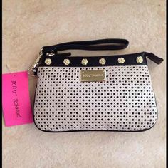 NWT-BETSEY JOHNSON WRISTLET Betsey Johnson Tuxedo Park Perforated Wristlet  Price and Shipping at Lowest  -Bone and black -Perforated faux leather - Zipper closure - Wristlet strap - Measures approximately 8.5 x 5.5 - Retail is $58.00 Betsey Johnson Bags Clutches & Wristlets