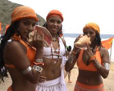 Afro Venezuelan dancers/chorus girls of Tambor Urbano demonstrate the use of the guarura.