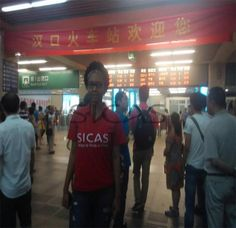 Tired But Contented For The Day  SICAS Student Service Team Member Delia picked up Sasha, who was admitted by Huazhong University of Science and Technology, at Hankou railway station. They had a tired but contented day.   Why? Follow the story, you will find the answer.