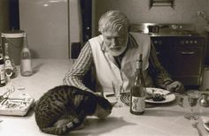 Ernest Hemingway with one of his famous cats....