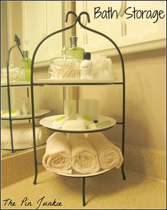 Use a plate stand for extra bathroom storage.  Smart!