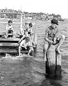 Young boys fishing at Rushcutters Bay Park in the eastern suburbs of Sydney during school holidays on 16th December 1938.