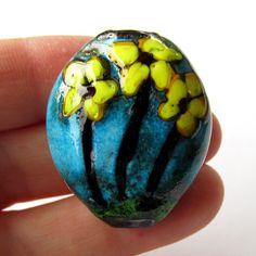 Handmade Lampwork Glass Focal Bead Pendant copper blue floral turquoise. $15.00, via Etsy.