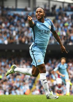 Raheem Sterling of Manchester City celebrates scoring the opening goal during…