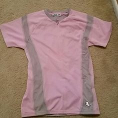 Cycling Short Sleeve Shirt Beautiful Pink and Gray Short Sleeve Cycling Shirt light,  yet Thermal control.  Never worn. Small zipper in the back with small  zippered  pocket, and pockets in the front. Pearl iZumi Tops Crop Tops