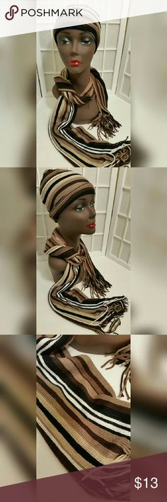 Striped hat and scarf set osfm Striped hat and scarf set   One size fits most  Light and dark Brown tan black white  Good condition but has a small hole see pics.. it can be sewn  No material content tag  Scarf is 72in. Long 9.5in. Wide Accessories