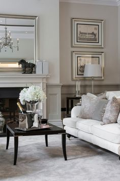 Love the silver frames, moulding, color scheme. Just perfect