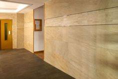 Great selection of #ceramic materials for the entrance of a building in Sierra Nevada!! - #Customized #ceramic #wall with #Emotile - Cuarcita series on the #walls - Filita Gris on the #floor