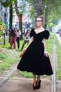 We've been bewitched by this black velvet dream dress and those super high heels.