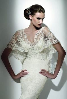 LOVE this dress! The top is amazing! I just don't like the shiny beading in center. (Pronovias)