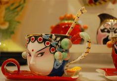 Cups are painted with Peking Opera mask