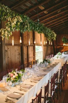 Hanging lights and long tables gussy up a #barn reception | Photography: http://laurenfairphotography.com | Design: www.oleanderbotanicals.com