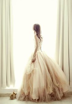 Just awe. Such a soft, pretty dress and beautiful lighting!